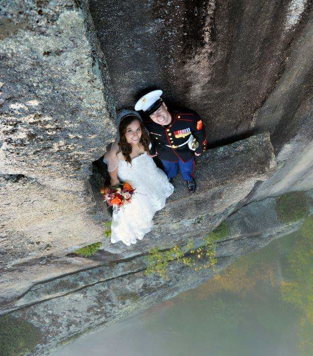 Bride and Groom standing on cliff.