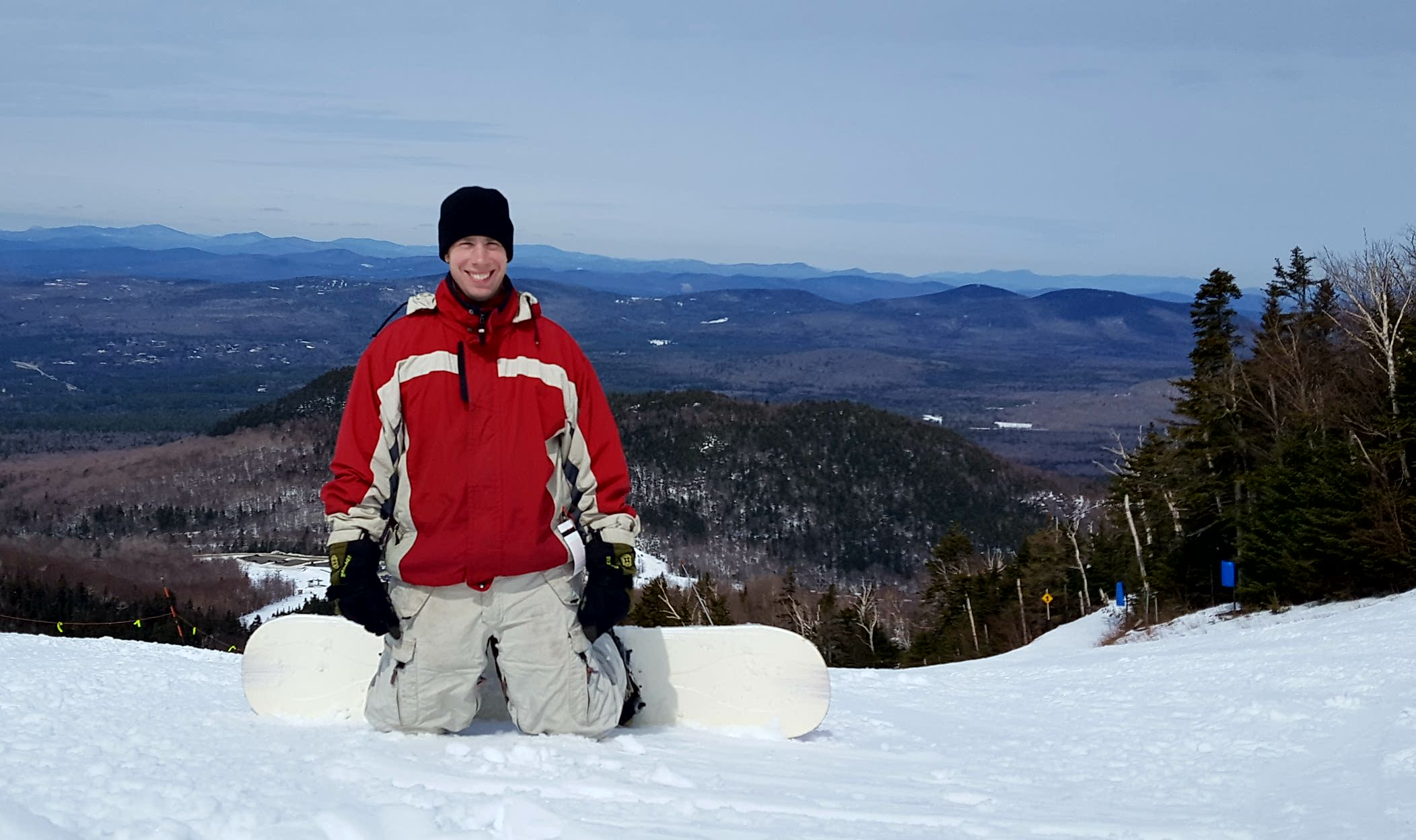 Snowboarder on top of Cannon Mountain