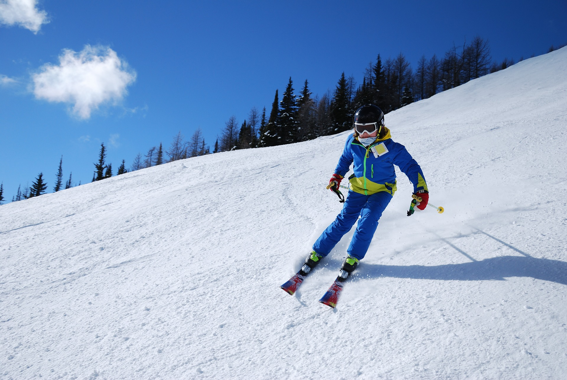 Skier slaloming down a hill